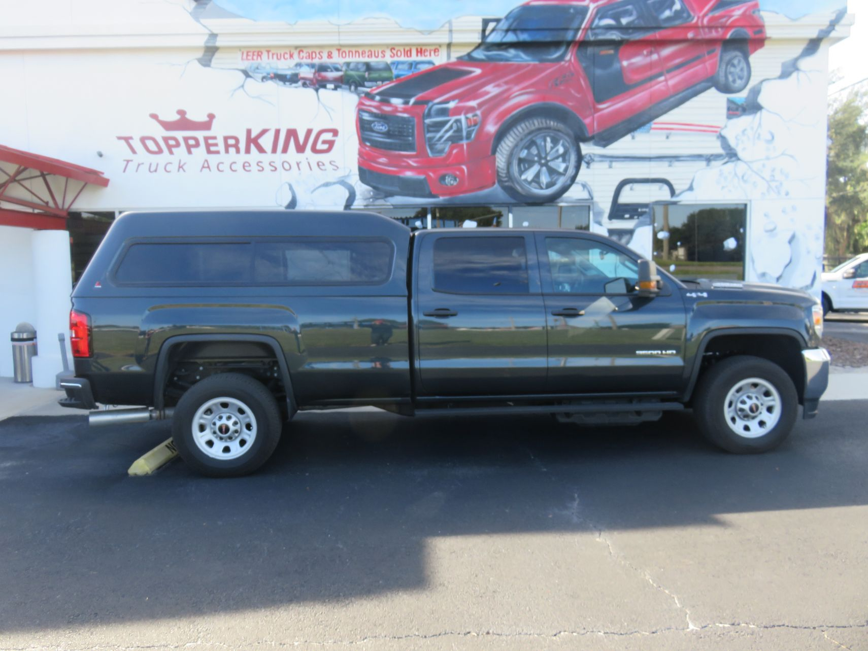 2019 Chevrolet Silverado with LEER 180 Nerf bars, Hitch, and Tint by TopperKING in Brandon, FL 813-689-2449 or Clearwater, FL 727-530-9066. Call today!