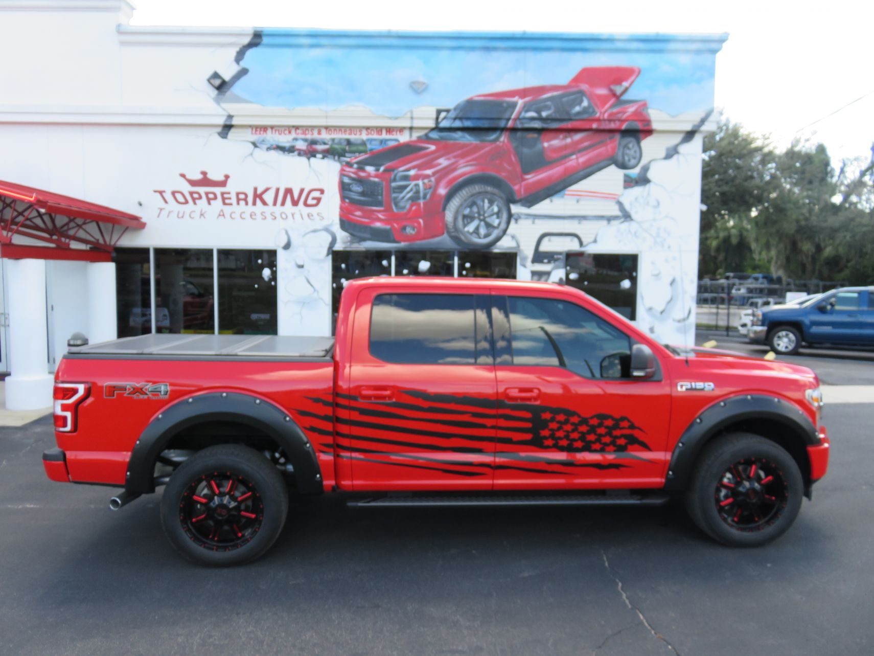 2019 Ford F150 with LEER 350M Custom Graphics, Fender Flares, Nerf Bars by TopperKING in Brandon, FL 813-689-2449 or Clearwater, FL 727-530-9066. Call now!
