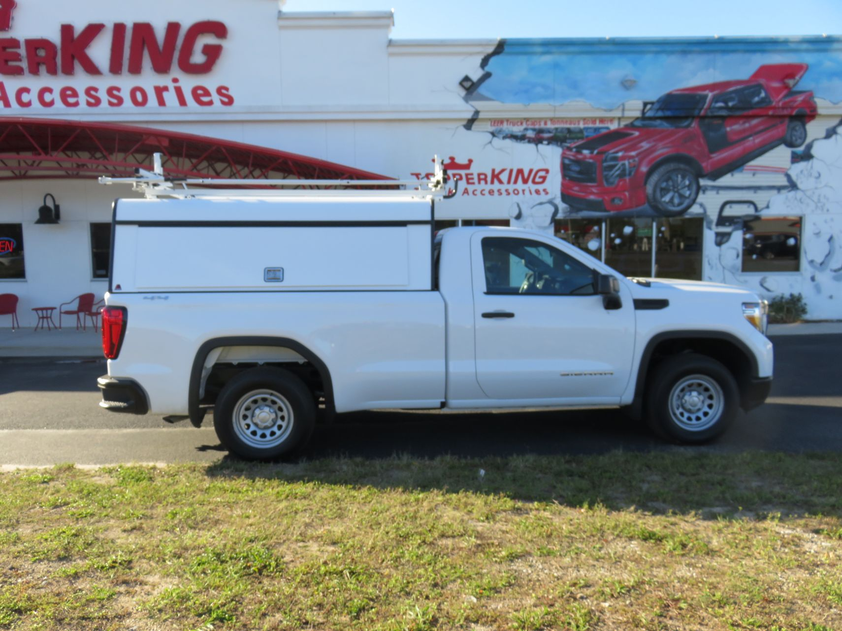 2020 White GMC Sierra with LEER DCC, Roof Racks, and Hitch by TopperKING in Brandon, FL 813-689-2449 or Clearwater, FL 727-530-9066. Call today to start!