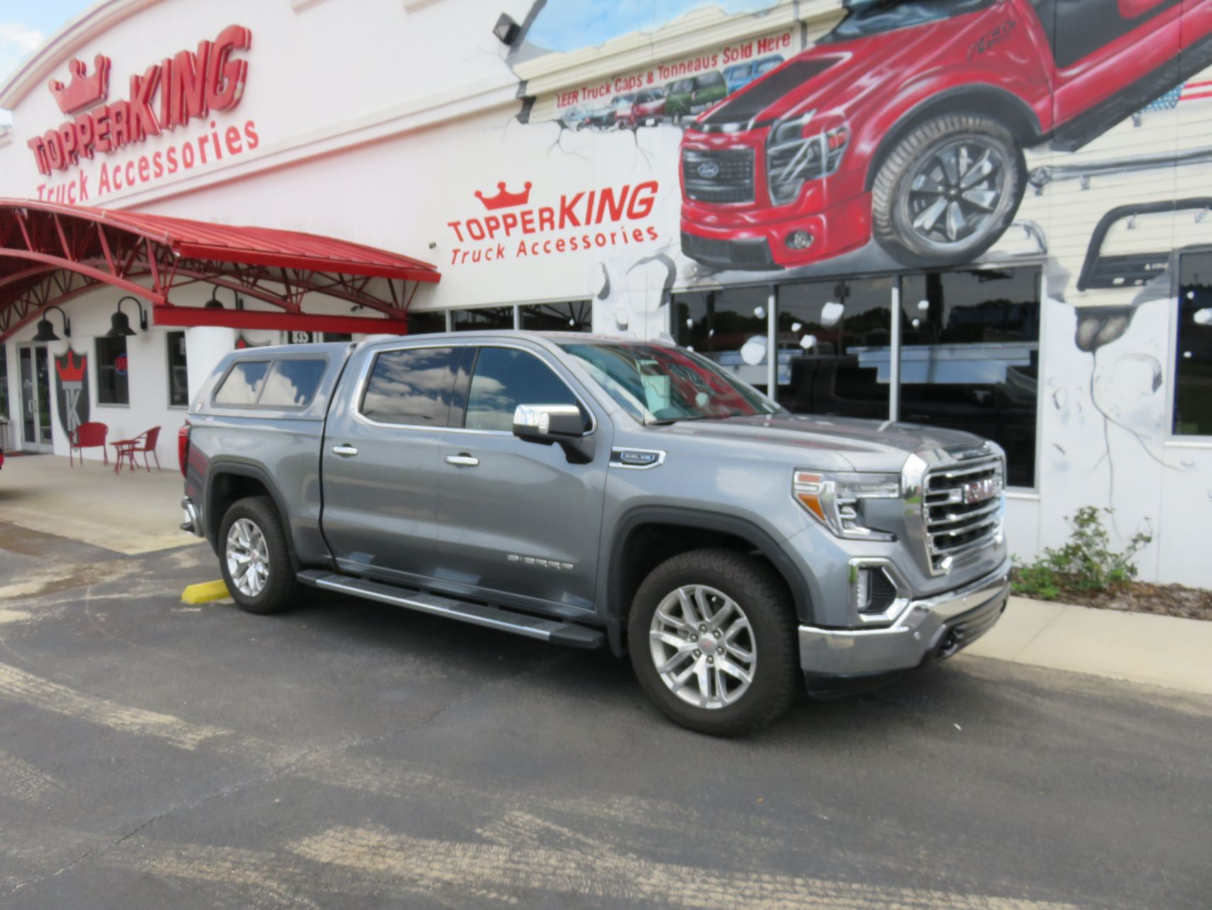 2020 GMC Sierra with TK Defender Fiberglass Topper, Nerf Bars, Chrome, Tint, Hitch by TopperKINGBrandon 813-689-2449 or Clearwater FL 727-530-9066. Call Us!