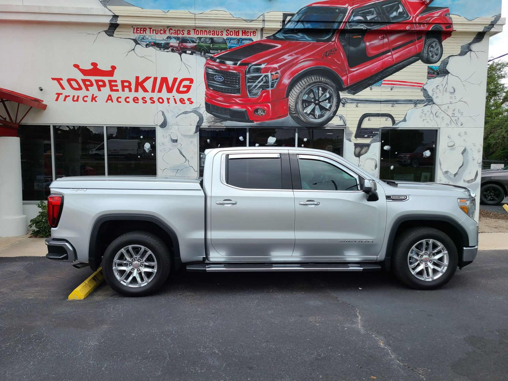 2020 GMC Sierra with LEER 700 Lid, Vent Visors, Bug Guard, Running Boards, Hitch, Tint by TopperKING Brandon 813-689-2449 or Clearwater 727-530-9066. Call!
