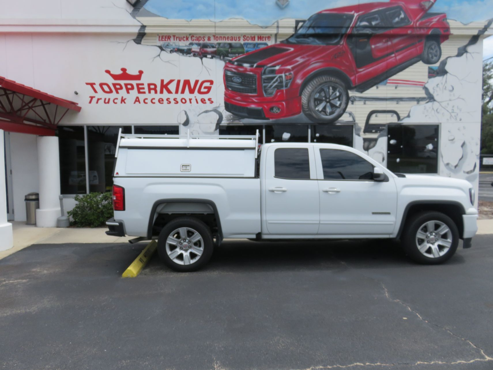 GMC Sierra with LEER DCC Commercial Topper, Side Access Doors, Ladder Rack, Tint, Hitch, Call TopperKING Brandon 813-689-2449 or Clearwater FL 727-530-9066.