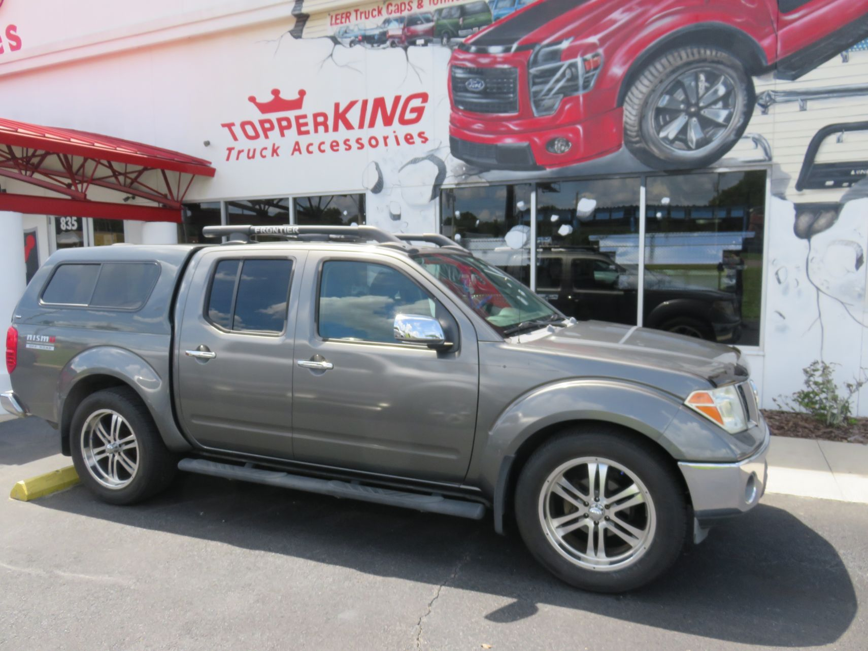 2006 Nissan Frontier with Ranch Sierra Fiberglass Topper, Nerf Bars, Bug Guard, Tint. Call TopperKING in Brandon 813-689-2449 or Clearwater FL 727-530-9066.
