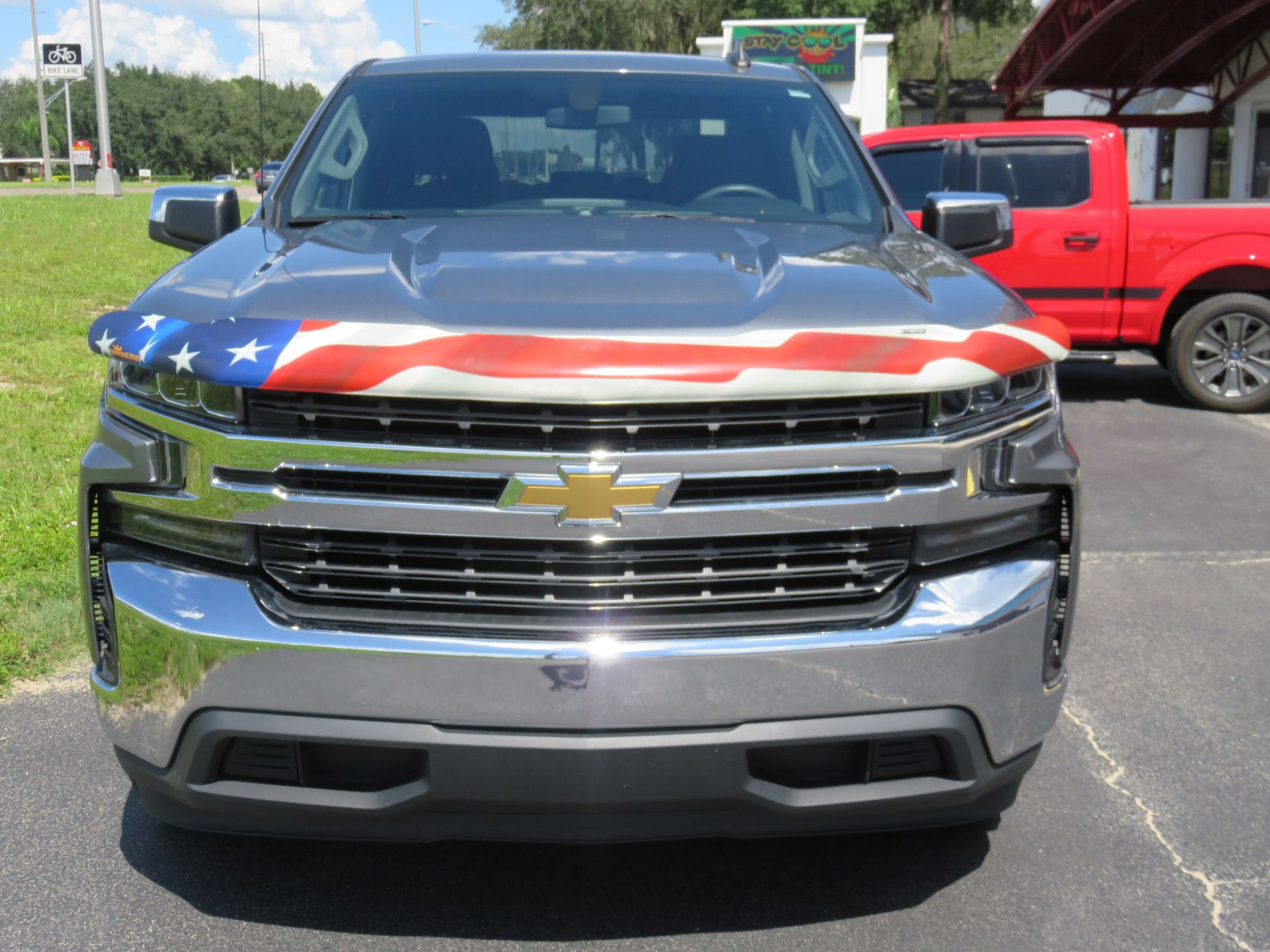 2020 Chevy Silverado with American Flag Hood Guard, Bedliner, Tint, Hitch. Call TopperKING Brandon 813-689-2449 or Clearwater FL 727-530-9066!