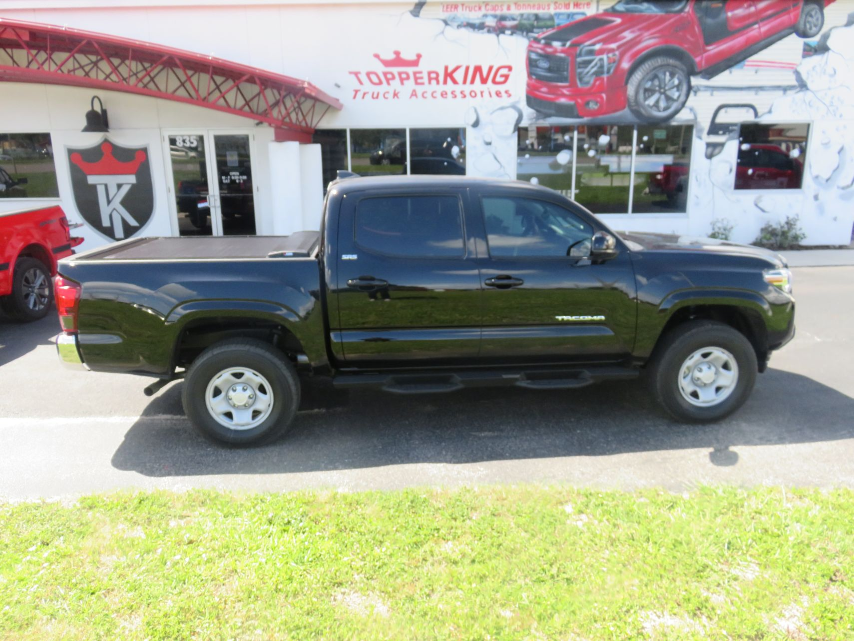 2020 Toyota Tacoma with LEER Switchblade, Side Steps, Tint, Hitch by TopperKING Brandon 813-689-2449 or Clearwater FL 727-530-9066. Call Now!