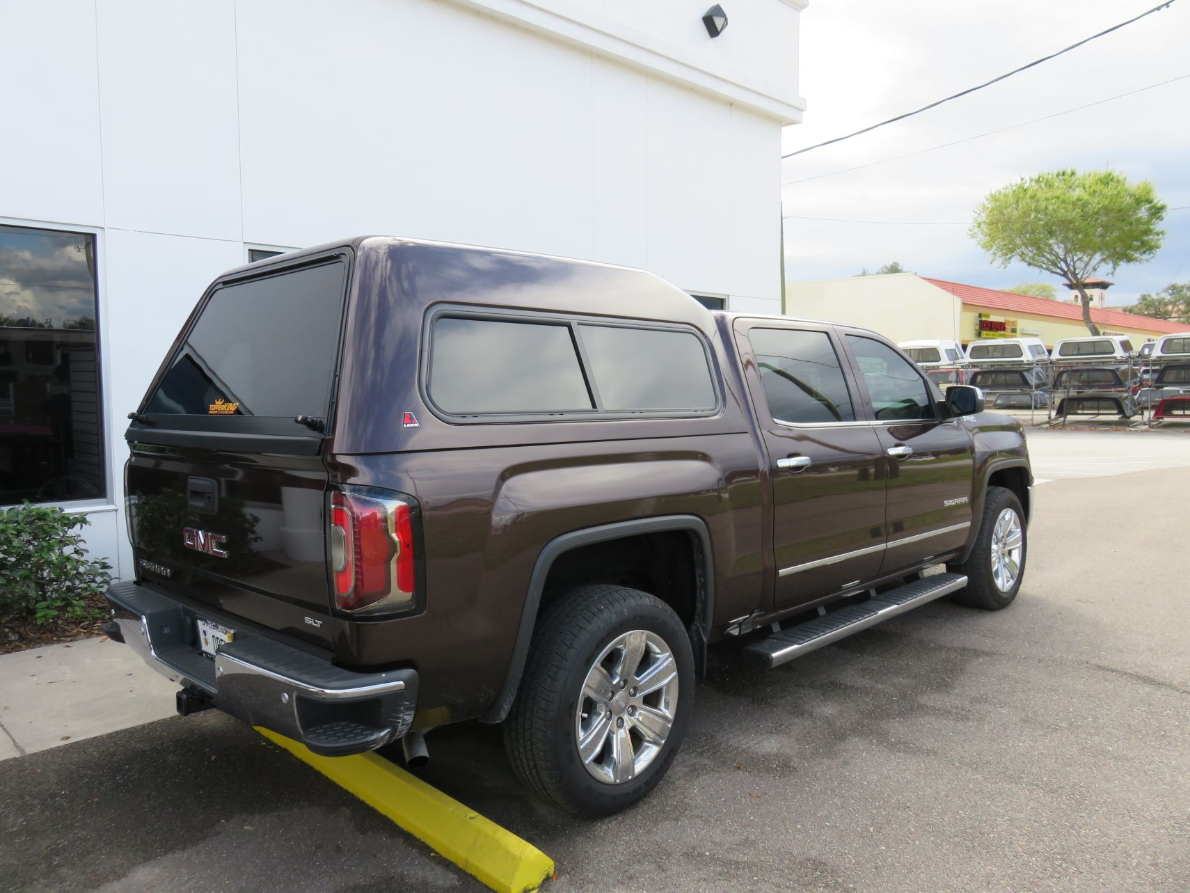2018 Chevy Silverado with LEER 180, Side Steps, Chrome, Tint, Hitch by TopperKING Brandon 813-689-2449 or Clearwater FL 727-530-9066. Call Us!