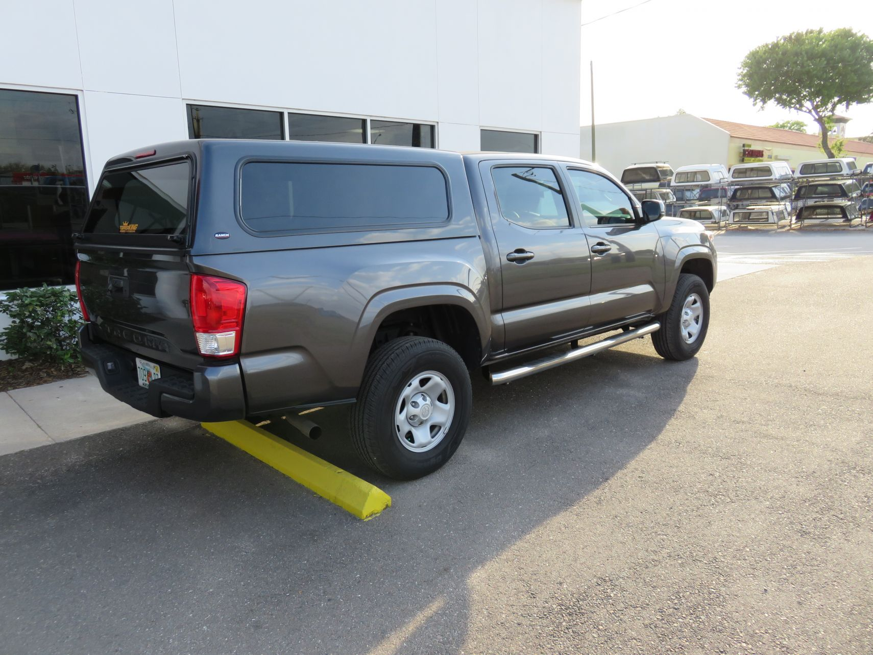 2019 Toyota Tacoma with Ranch Echo, Nerf Bars by TopperKING Brandon 813-689-2449 or Clearwater FL 727-530-9066. Call us today to start!