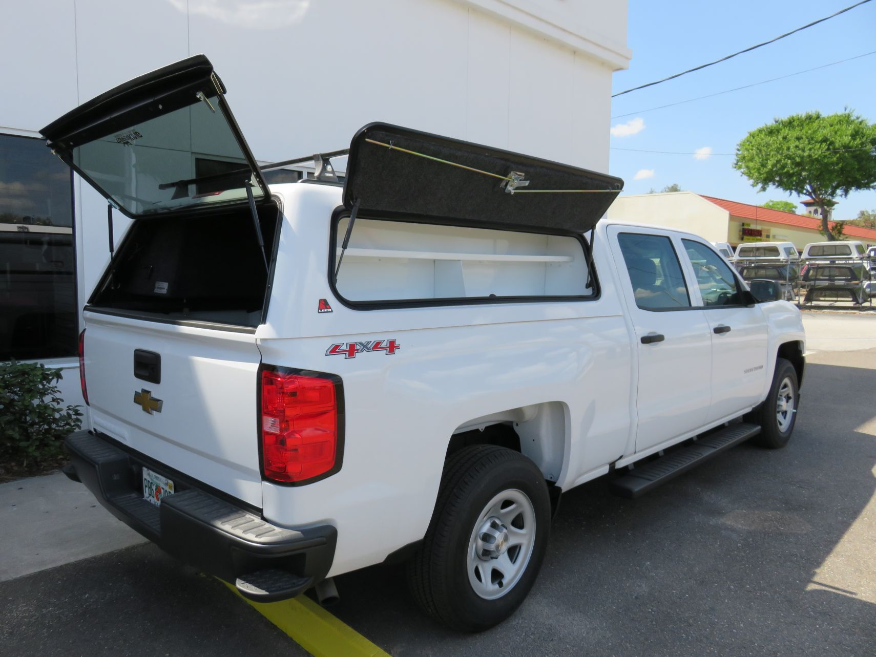 2019 Chevy Silverado LEER 100RCC, Nerf Bars, Roof Racks, Side Access, Tool Box by TopperKING Brandon 813-689-2449 or Clearwater 727-530-9066.