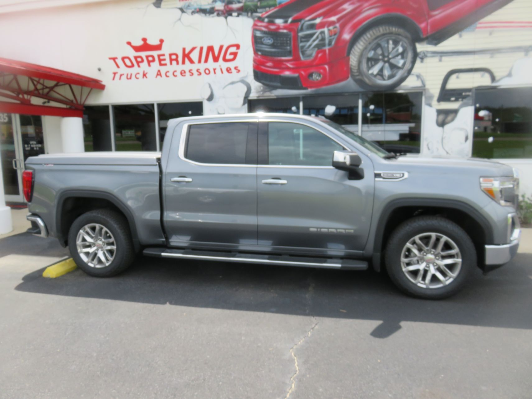 2020 GMC Sierra with LEER 700, Side Steps, Chrome, Tint, Hitch by TopperKING Brandon 813-689-2449 or Clearwater FL 727-530-9066. Call today!