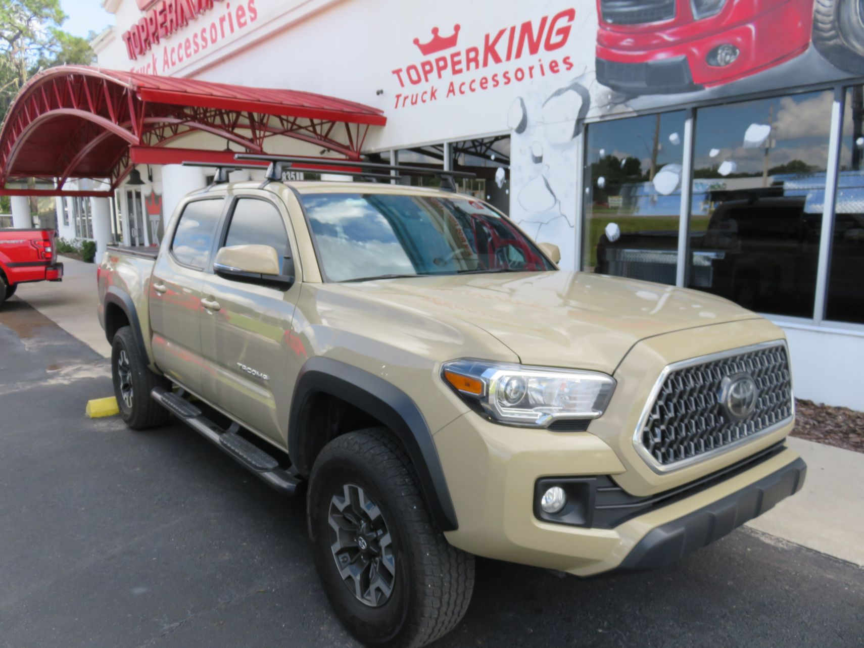 2020 Toyota Tacoma with Yakima Racks, Folding Tonneau, Nerf Bars by TopperKING Brandon 813-689-2449 or Clearwater FL 727-530-9066. Call us!