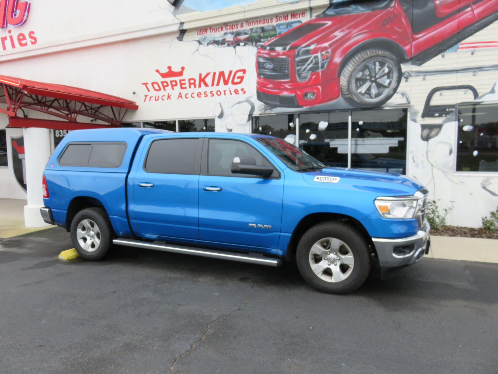 2020 Dodge RAM with LEER 180, Running Boards, Tint, Hitch by TopperKING Brandon 813-689-2449 or Clearwater FL 727-530-9066. Callus today!