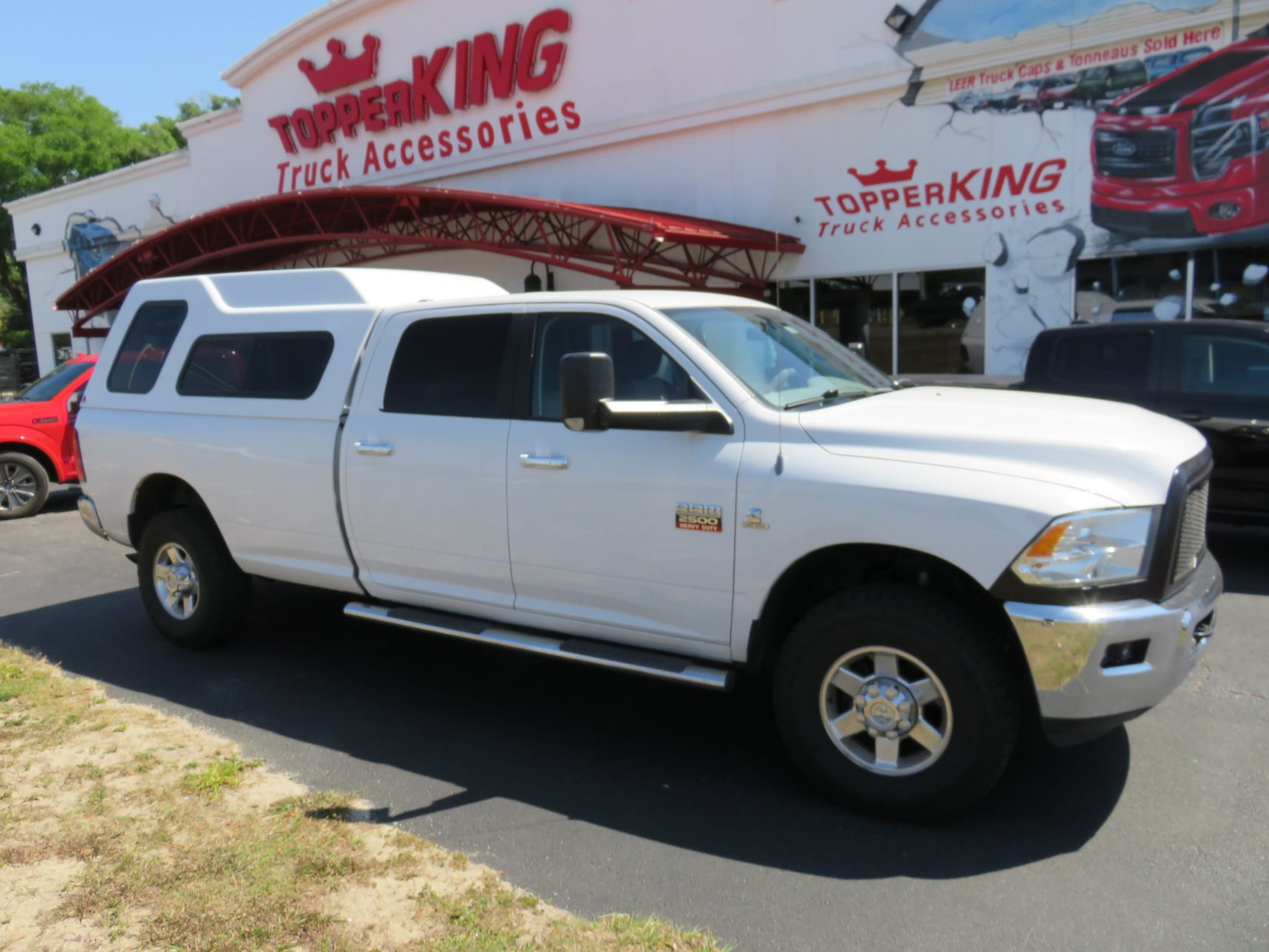 2012 Dodge RAM with LEER 122, Nerf bars, Windoor, Tint, Hitch by TopperKING Brandon 813-689-2449 or Clearwater FL 727-530-9066. Call Today!