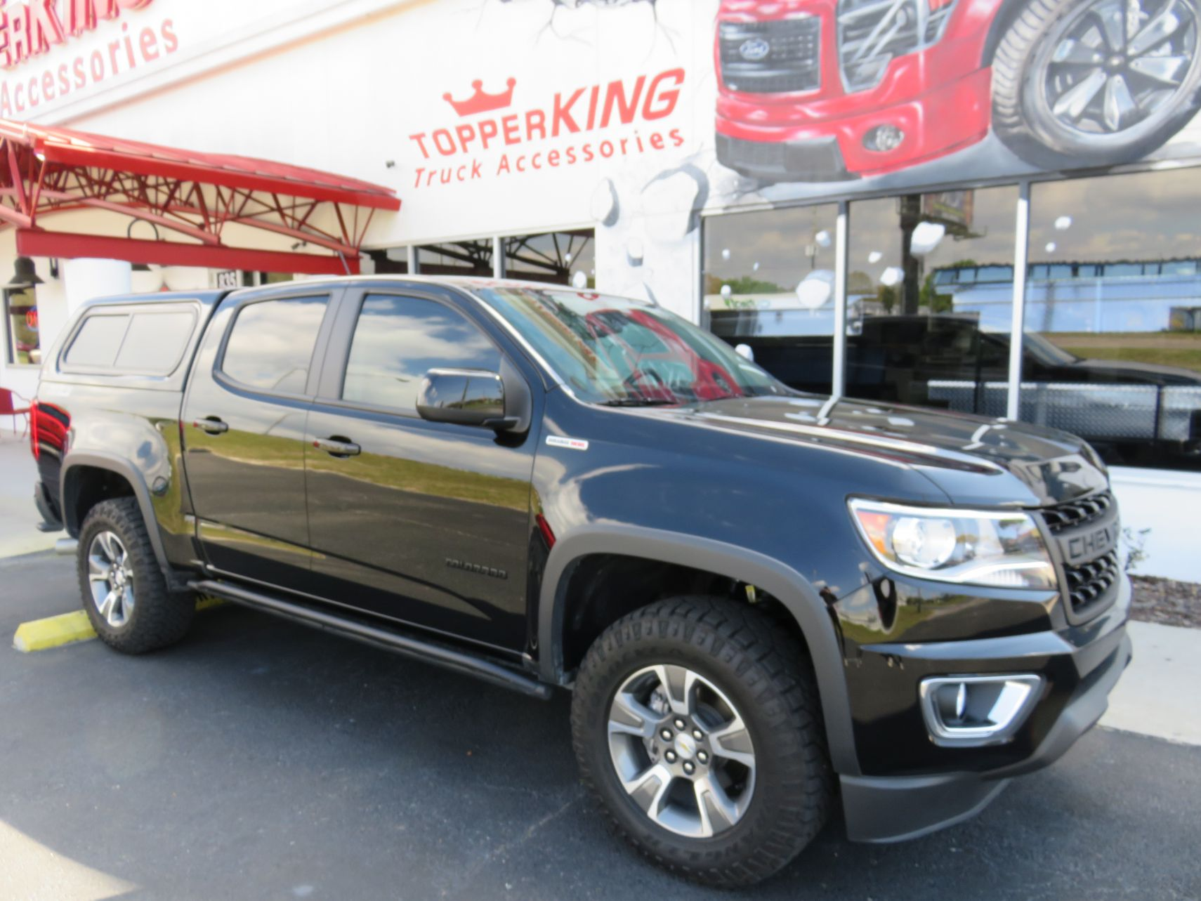 2020 Chevrolet Colorado with LEER 100XR, Side Steps, Tint, Hitch by TopperKING Brandon 813-689-2449 or Clearwater FL 727-530-9066. Call us!