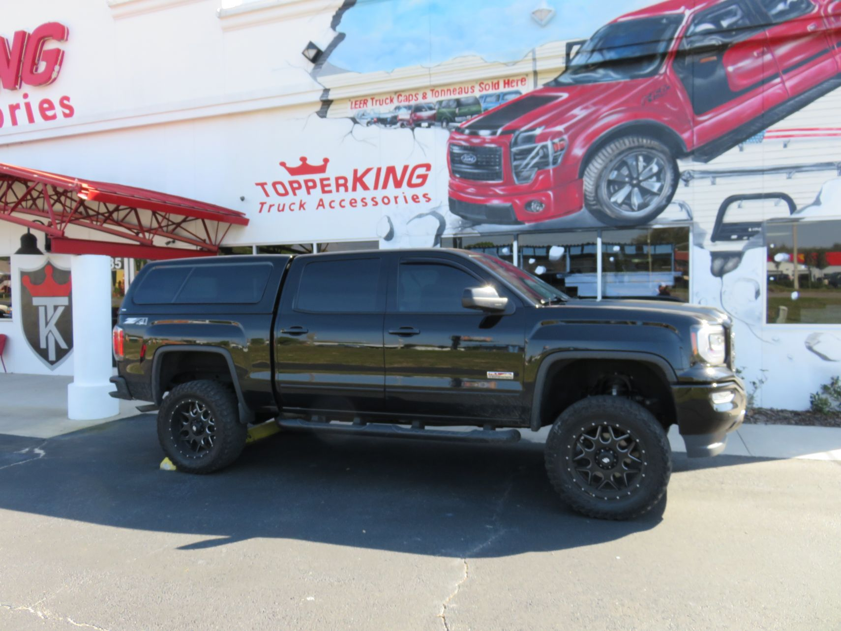 2020 GMC Sierra with Ranch Icon, Black Out Nerf Bars, tint, Hitch by TopperKING Brandon 813-689-2449 or Clearwater FL 727-530-9066. Call us!