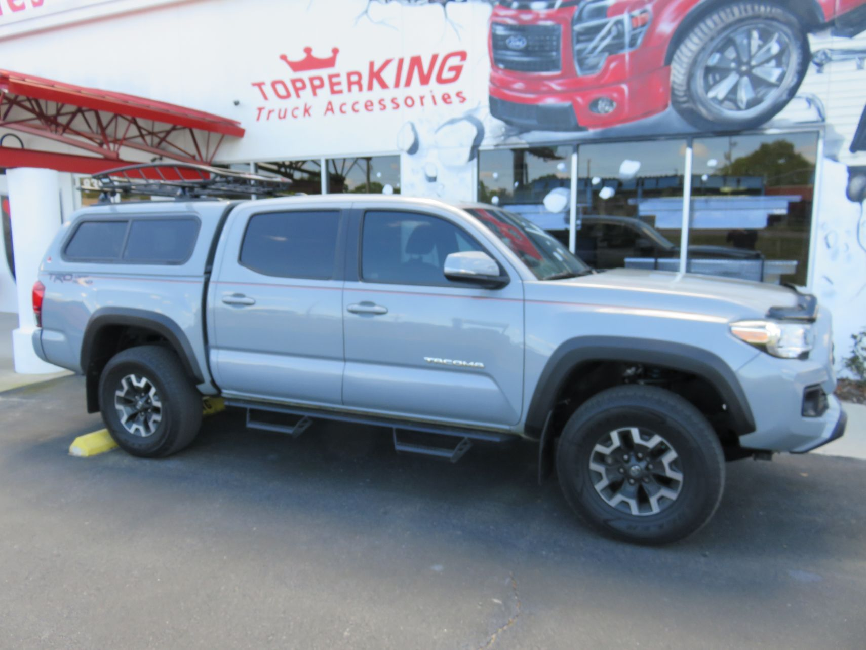 2020 Toyota Tacoma with LEER 100XR, Yakima, Drop Down Side Steps by TopperKING Brandon 813-689-2449 or Clearwater FL 727-530-9066. Call Us!