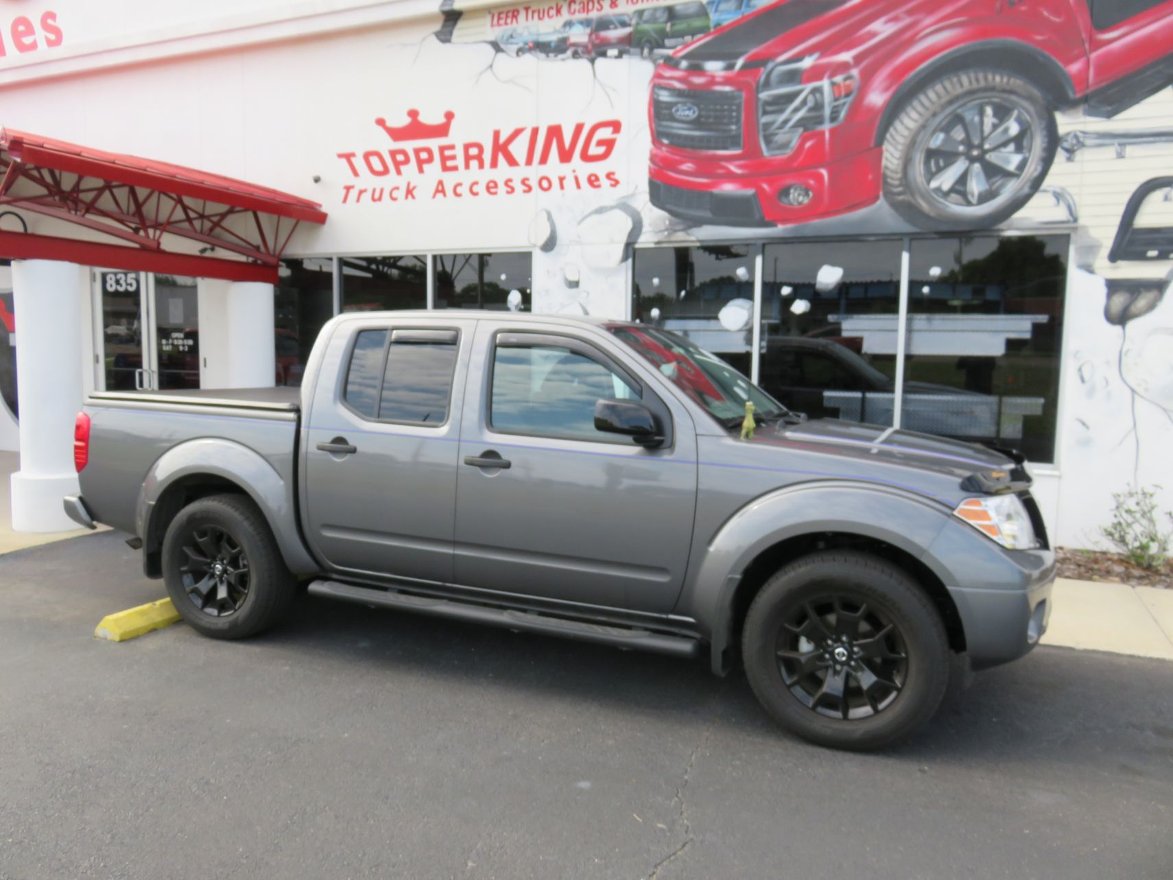 2020 Nissan Frontier with TruXport, Vent Visors, Nerf Bars, Hitch, Tint. Call TopperKING Brandon 813-689-2449 or Clearwater FL 727-530-9066.