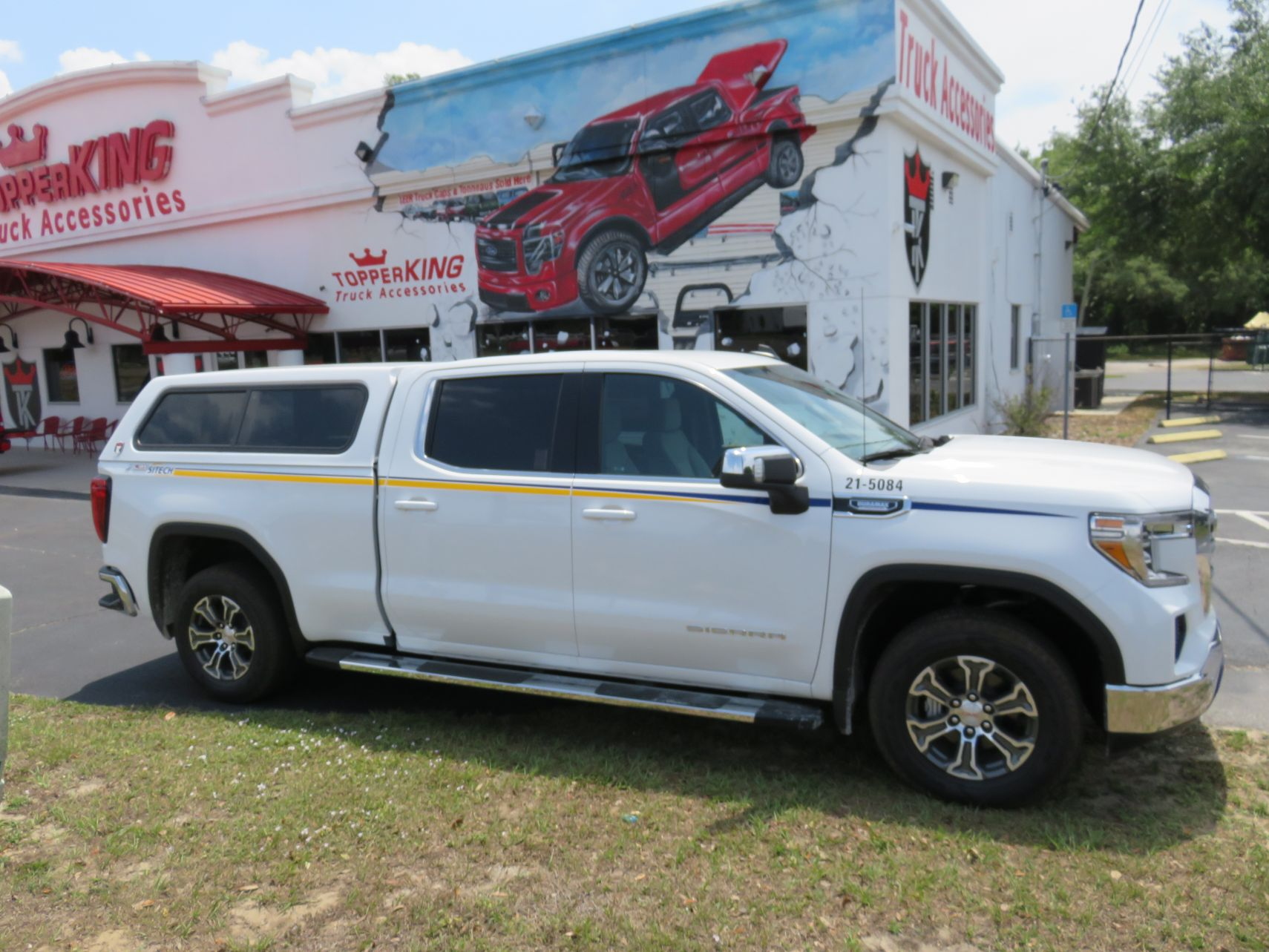 2020 GMC Sierra with TK Defender, Running Boards, BedSlide, Hitch. Call TopperKING Brandon 813-689-2449 or Clearwater FL 727-530-9066 today!